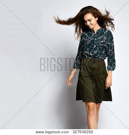 Cheerful Young Woman Posing Alone, In A Dark Silk Blouse With Floral Patterns, In A Dark Short Green