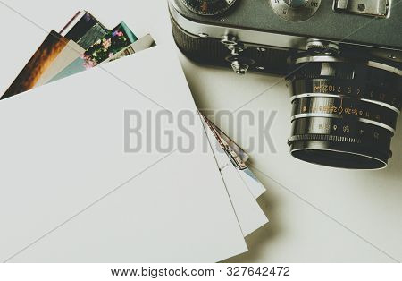 Old Retro Camera On Vintage White Background