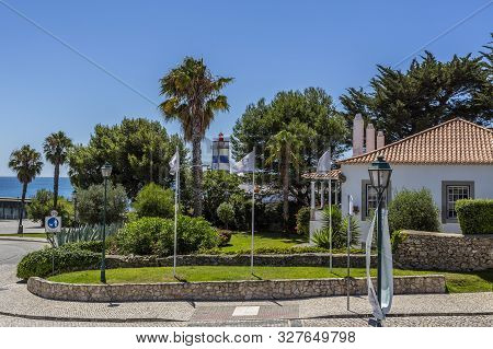 Cascais - August 14, 2019: View Of The Wonderful Santa Marta Lighthouse Seen Through The Trees Of An