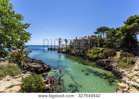 Cascais - August 14, 2019: Superb View Of The Inlet Along The Rocky Coastline Near The Santa Marta L