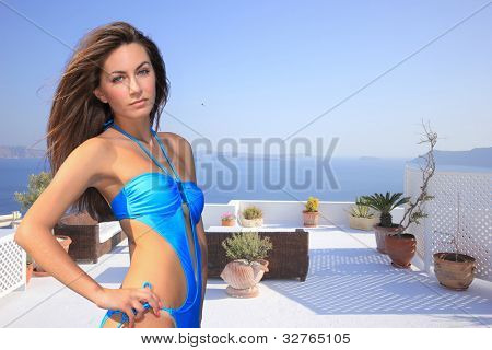 Beautiful young Greek woman  posing in Santorini