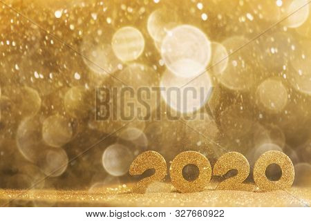 2020 New Year luxury design concept. Golden 2020 New Year horizontal template with golden glitter backgound