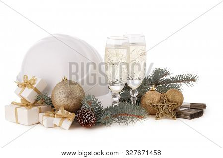 Construction hard hat, fir tree branches, two glasses with champagne, gift boxes and Christmas ornament isolated on a white background. New Year and Christmas construction background