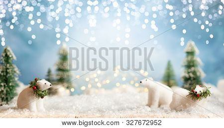 Beautiful winter background with white bears, fir trees and blue sky. Winter, New Year and Christmas concept with snowy background.