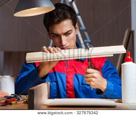Young man gluing wood pieces together in DIY concept poster