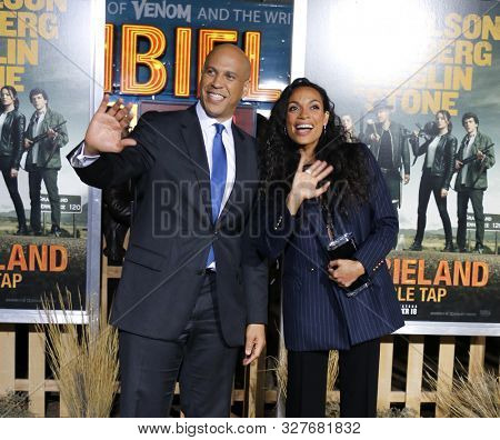actress Rosario Dawson and senator Cory Booker at the Los Angeles premiere of 'Zombieland Double Tap' held at the Regency Village Theatre in Westwood, USA on October 10, 2019.