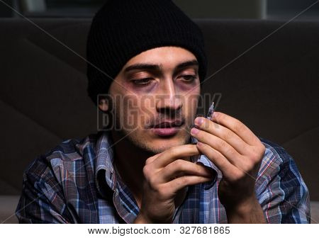 The young man in agony having problems with narcotics