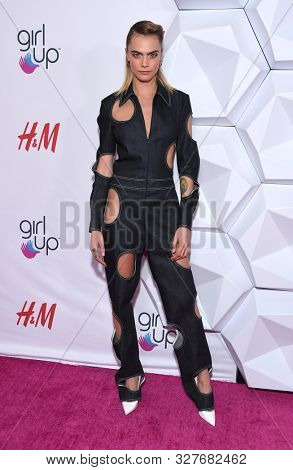 LOS ANGELES - OCT 13:  Cara Delevingne arrives for the 2nd Annual Girl Up #GirlHero Awards on October 13, 2019 in Beverly Hills, CA