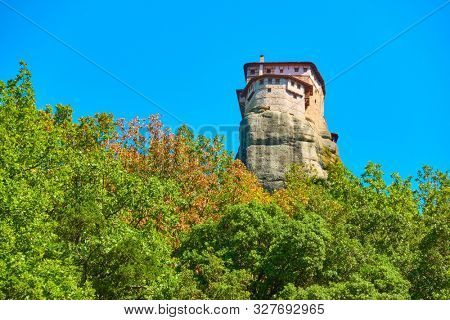 The Monastery of Rousanou on the cliff in Meteora, Greece. Copyspace composition