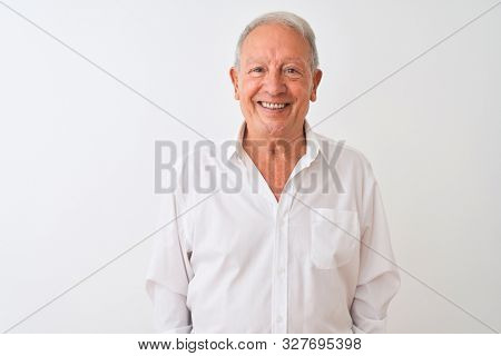 Senior grey-haired man wearing elegant shirt standing over isolated white background with a happy and cool smile on face. Lucky person.