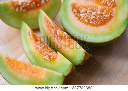 Sliced Cantaloupe Thai Tropical Fruit Asian On Wooden Background / Cantaloupe Melon Muskmelon Cucurb