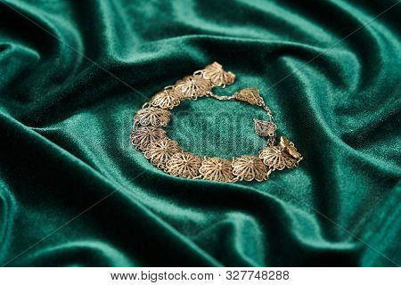 Beautiful Silver Bracelet. Luxury Women Bracelet On Green Silk Background