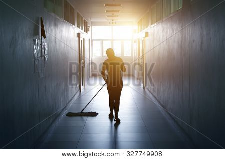 Janitor Woman Mopping Floor In Hallway Office Building Or Walkway After School And Classroom Silhoue
