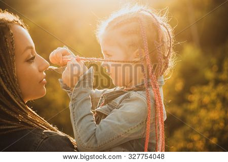 Hair In Trendy Weave Plait. Happy Loving Family - Mother And Daughter. Braiding Hair. Nice Child Gir