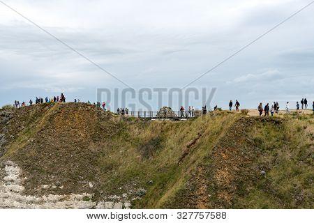 Etretat, Seine-maritime / France - 14 August 2019:  Tourists Enjoy Hiking On The Normandy Coast Alon