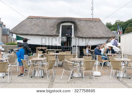Etretat, Seine-maritime / France - 14 August 2019: Tourists Enjoy Snacks And Drinks In The Old Fishi