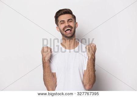 Overjoyed caucasian man feel euphoric with success poster