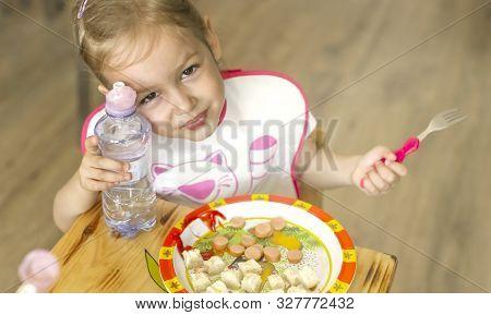 Girl  Breakfasting  Sausages