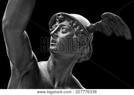 Ancient statue of the antique god of commerce, merchants and travelers Hermes - Mercury. He is olympic gods messenger with wings on a helmet. Sculpture isolated on black background by clipping path