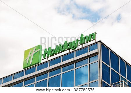 Krakow, Poland - July 12, 2019: Holiday Inn Sign Against A Cloudy Blue Sky. Holiday Inn Is The Ameri