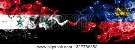 Syria Vs Liechtenstein, Liechtensteins Smoke Flags Placed Side By Side. Thick Colored Silky Smoke Fl