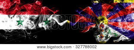Syria Vs Tibet, Tibetan Smoke Flags Placed Side By Side. Thick Colored Silky Smoke Flags Of Syrian A