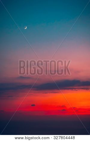 Beautiful sunset with a moon, new moon, beauty of a moon cycle, amazing night skyscape, autumn season nature