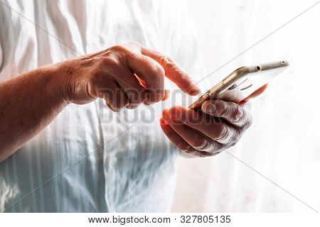 Older Woman Hands. Using Touch Screen Phone. Old People And Technology