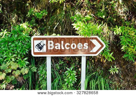Brown Tourist Sign Giving Direction To The Famous Levada Dos Balcoes Trail In Madeira, Portugal. Inf