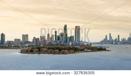 View of Ellis Island with Jersey City and Manhattan Island in the background.