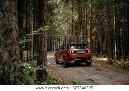 Minsk, Belarus - September 24, 2019: Land Rover Discovery Sport On Country Road N Autumn Forest Land
