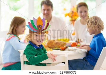 Family With Kids At Thanksgiving Dinner. Turkey.
