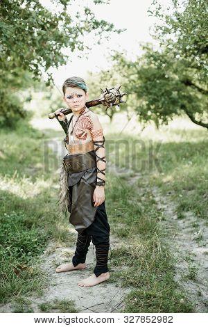 Cosplay Of Ukrainian Kozak. Cute Caucasian Boy Holding Mace With Emblem Of Ukraine Pretending To Be