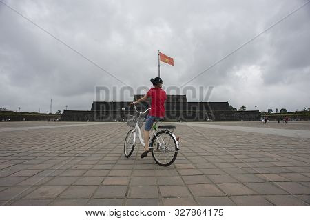 Hue, Thua Thien-hue, Vietnam - February 27, 2011: A Vietnamese Girl With Red Shirt Cycling In A Whit