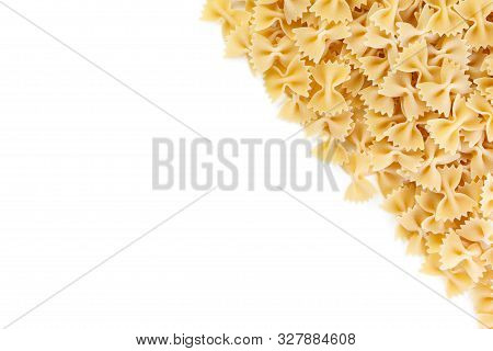Variety Of Types And Shapes Of Italian Pasta. Dry Pasta Background. A Portion Of Farfalle Bows Pasta