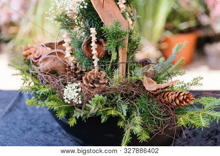 Grave decoration in autumn colors for sale in gardening shop