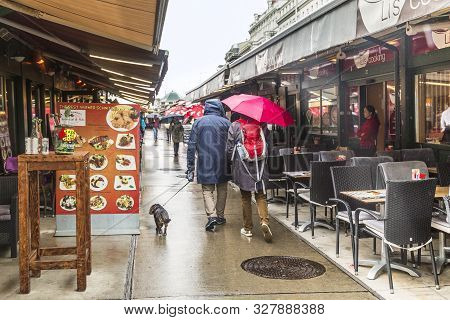 Vienna, Autria - May 22, 2019: These Are The Empty Rows Of The Naschmarkt Market In The Rain.