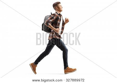 Full length profile shot of a male teen student running isolated on white background