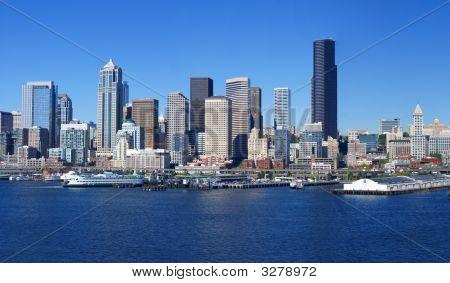 Waterfront Skyline,With Ferry And Dockyard
