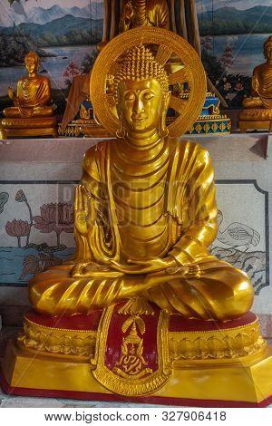 Bang Saen, Thailand - March 16, 2019: Wang Saensuk Buddhist Monastery. Closeup Of Golden Bodhisattva