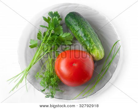 Tomato, Cucumber, Celery, Garlic And Dill On A Plate