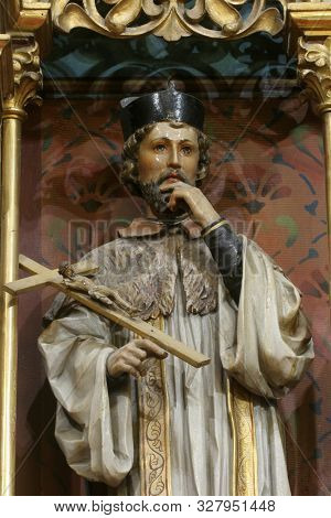 IVANIC GRAD, CROATIA - SEPTEMBER 25, 2011: Saint John of Nepomuk, statue on the main altar of the Visitation of Mary in the church of the Saint Peter in Ivanic Grad, Croatia