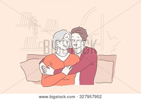Respect For Elderly People, Senile Persons Concept. Son Hugging Grey Haired Mother, Cheerful Grandso