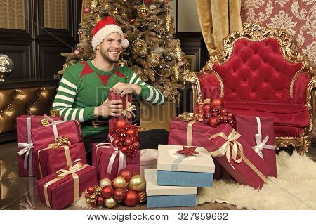 You Only Get This At Christmas. Delivery Christmas Gifts. Guy Is Celebrating Christmas At Home. Man