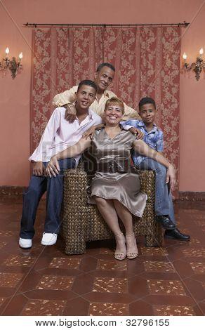 Hispanic family sitting on chair