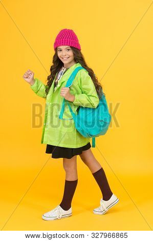 Backpack that best fits kids workload. Small girl with backpack travel on autumn holidays. Little child wear school backpack on yellow background. Her backpack is as comfortable as cool. poster