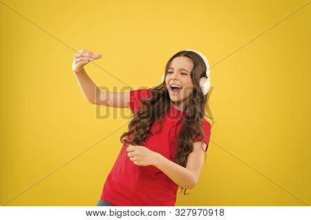When The Soul Is Singing. Adorable Small Child Singing On Yellow Background. Cute Little Girl Listen