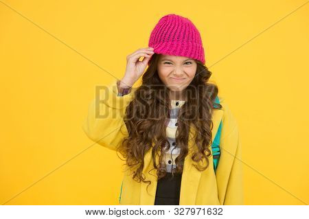 Hat Really Bothers Me. Small Kid Dislike Wearing Hat. Little Kid Take Off Hat On Yellow Background.