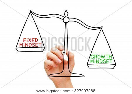 Hand Drawing Growth Mindset Or Fixed Mindset Scale Concept With Black Marker On Transparent Wipe Boa