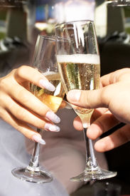 Two Glasses With Champaign In Hands